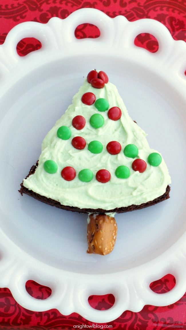 Great idea! Bake brownies in a round pan, cut into wedges, top with green frosting and Mini M&Ms for lights and add a pretzel for the tree trunk!
