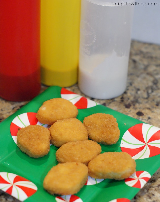 Make gingerbread men out of Tyson Chicken Nuggets for holiday fun! #MealsTogether