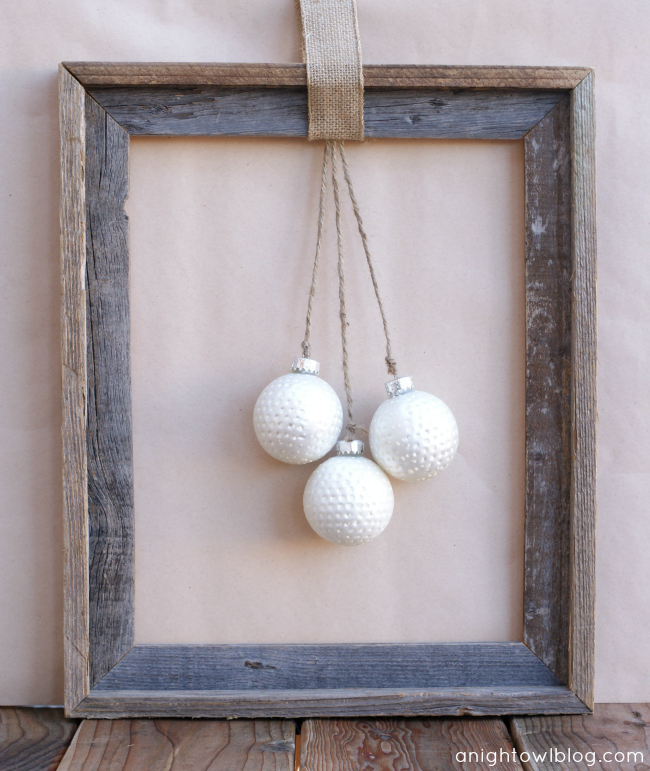 Rustic Christmas Wreath by @anightowlblog - just an open wooden frame, burlap, twine, ornaments and some thumbtacks and you can put together a beautiful frame in minutes!