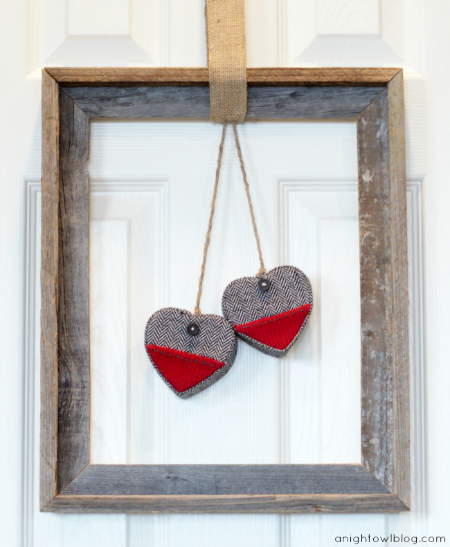 Wow - how easy! All you need is an open frame, twine, burlap and hearts to make this Easy Framed Valentine's Wreath! Learn more at anightowlblog.com