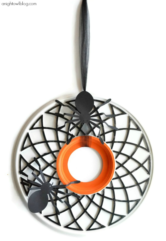 Fun and easy Spider Web Halloween Wreath made from a ceiling medalion at anightowlblog.com | #Halloween #decor #wreath