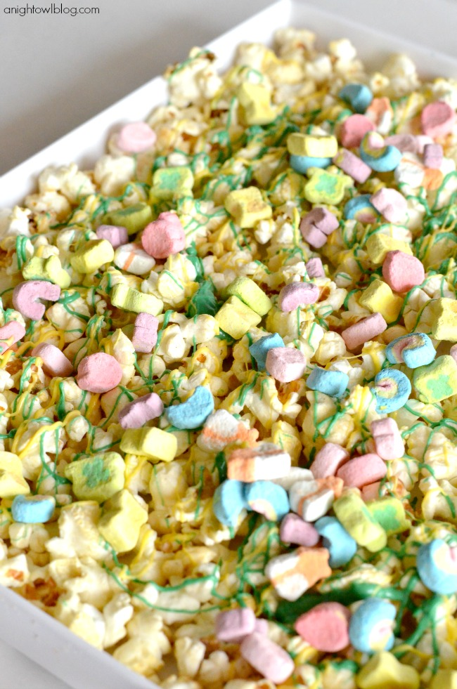 The perfect St. Patrick's Day treat! Lucky Charms Popcorn - so easy to make and so tasty - a snack the whole family will love!
