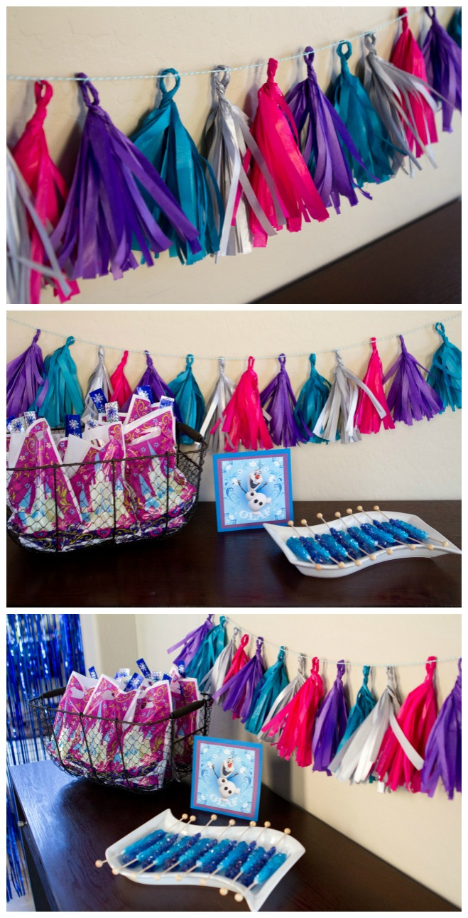 Adorable tissue garland and goody table - Disney Frozen Birthday Party Ideas