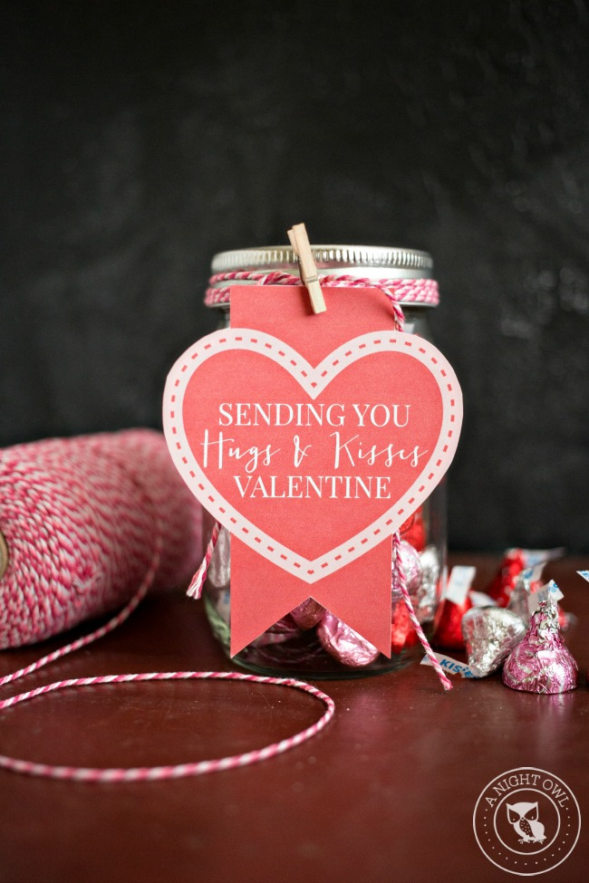 Perfect for sweet Valentine's Day gifts, create these Hugs and Kisses Mason Jar Valentines full of Hershey's Hugs and Kisses and an adorable free printable tag!