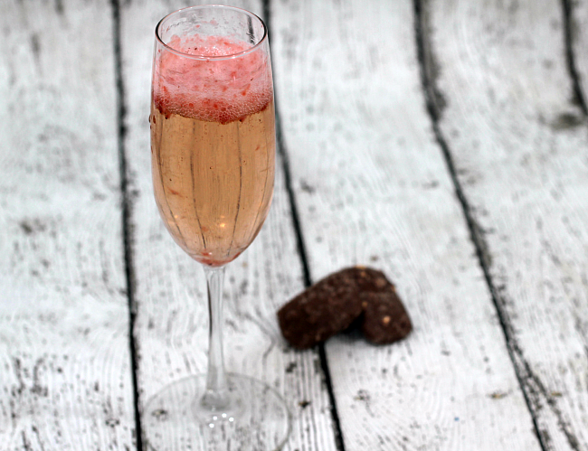 Light and refreshing champagne cocktail with a slight hint of strawberries. Perfect for Spring or Summer